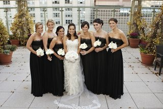 bride-with-bridesmaids-in-strapless-black-dresses