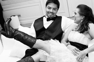 black-and-white-photo-of-bride-wearing-cowboy-boots