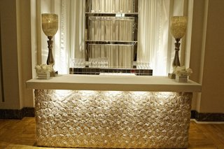 bar-station-wrapped-with-rosette-linens-and-large-candleholder