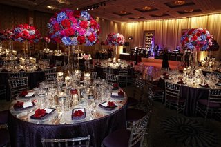 mirror-wedding-tables-with-purple-and-red-centerpieces