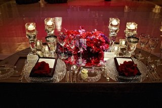 bold-red-and-purple-flower-centerpiece-on-couples-table