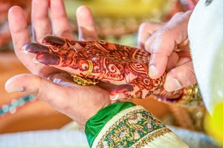 intricate-indian-bridal-mehendi-on-palm-of-hand