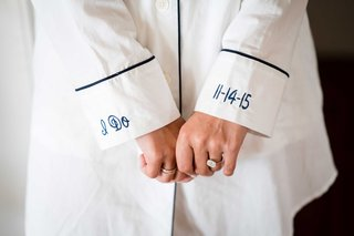 bride-getting-ready-outfit-close-up-of-cuffs-on-mens-shirt-pajamas-i-do-date-engagement-ring