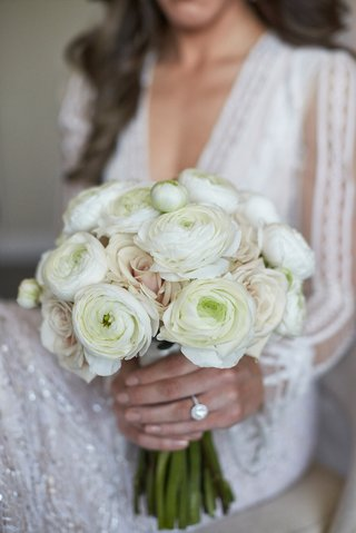bride-in-inbal-dror-wedding-dress-with-ivory-ranunculus-blossoms-and-light-pale-pink-roses