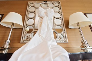back-of-gown-large-decorative-bow-wedding-modern-contemporary-museum-art-heavy-material
