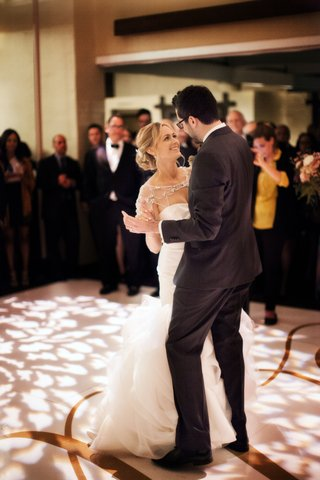 bride-in-trumpet-gown-dancing-with-groom-at-reception