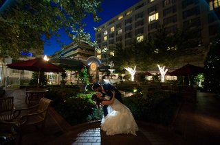 come-nightfall-a-groom-dips-his-new-bride-in-a-courtyard-in-washington-dc