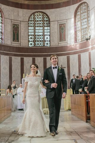 bride-and-groom-walk-down-aisle-in-italian-church
