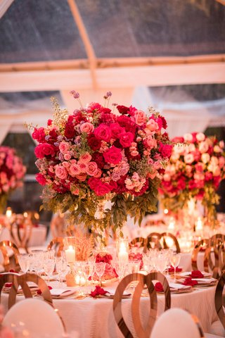 wedding-reception-tall-centerpiece-pink-roses-and-greenery-candles-gold-chairs-crystal-glassware