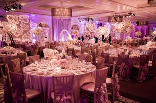 violet-and-rose-lighting-on-round-guest-tables