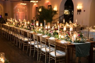 wedding-reception-key-west-florida-with-wood-table-and-greenery-runner-head-table-gold-candles