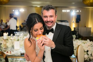 bride-eating-in-n-out-burger-at-wedding-reception-favors-late-night-snack