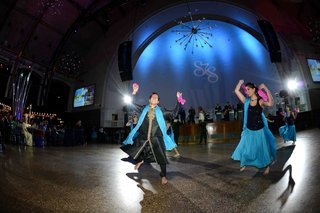 traditional-indian-dancers-in-blue-attire-at-reception