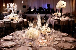 textured-tablecloths-and-white-floral-arrangements