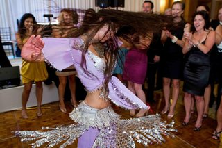 woman-belly-dancing-in-purple-and-silver-costume