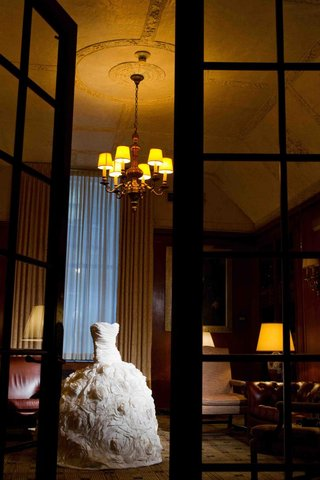 strapless-wedding-dress-in-high-ceiling-study