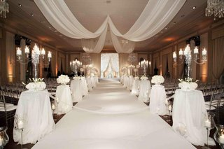 clear-candelabra-on-pedestals-and-chandeliers