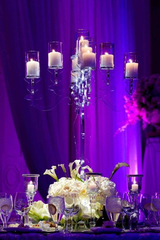 purple-lighting-on-clear-candelabra-centerpiece