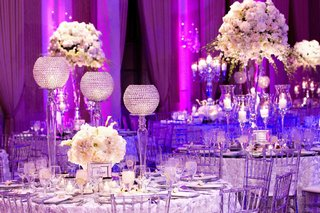 clear-lucite-chairs-and-white-rosette-linens