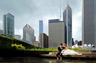 bride-and-groom-wading-in-lake-michigan