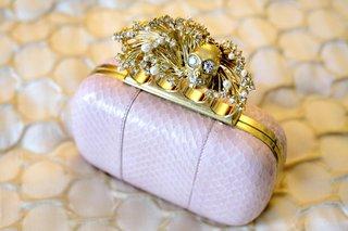 bridal-bag-with-gold-skull-finger-hardware