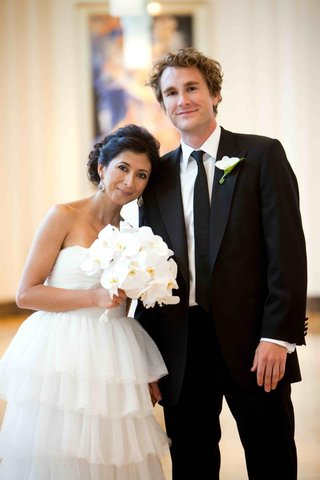 tiered-strapless-wedding-dress-and-black-suit
