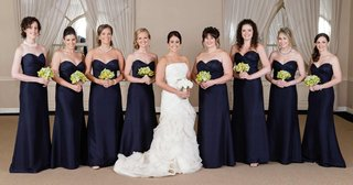 bridesmaids-in-floor-length-dresses-holding-nosegays