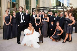 grey-black-bridesmaid-dresses-and-groomsmen-in-tuxedos