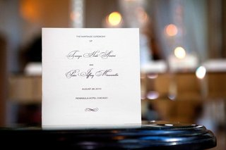 white-and-black-ceremony-booklet-on-table