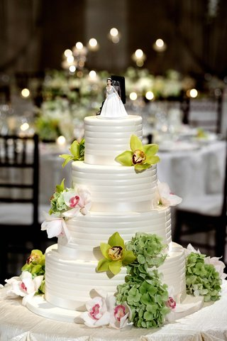 confection-topped-with-fresh-flowers-and-topper