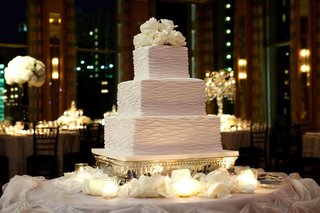 three-layer-wedding-cake-with-fresh-roses
