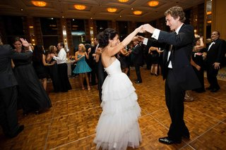 bride-in-monique-lhuillier-dress-and-groom-on-dance-floor