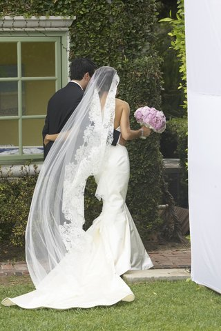 bride-wearing-tia-mazza-mantilla-veil