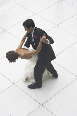 bride-and-groom-dancing-on-white-dance-floor