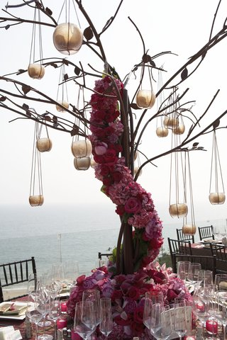 tall-centerpiece-with-pink-flowers-and-candles