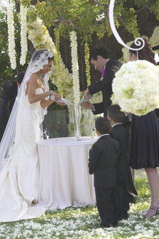 ring-bearers-watching-bride-and-groom