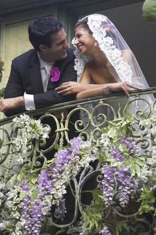 couple-on-balcony-adorned-with-flowers