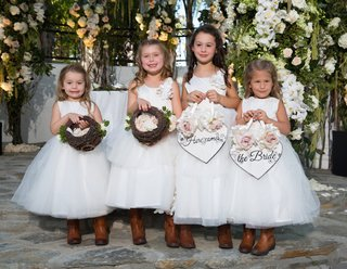 flower-girls-in-white-ball-gowns-with-rustic-cowboy-boots