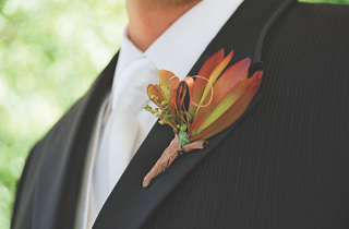 groom-wearing-orange-flowers-on-lapel