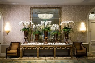 five-bronze-vases-with-white-orchids-at-escort-card-table