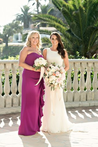 bride-white-sheath-dress-mother-fuchsia-pink-purple-dress-bouquets-balcony