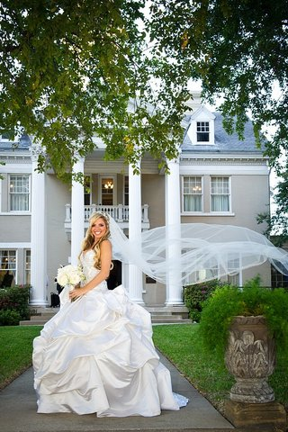 bridal-veil-blowing-in-wind-with-pick-up-ball-skirt