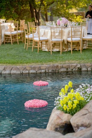 pink-bed-of-flowers-and-candles-on-backyard-pool
