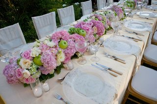 pink-and-green-flowers-atop-yellow-linens