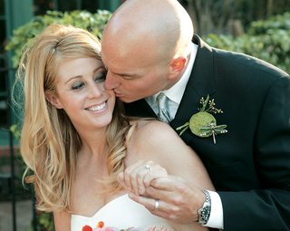 groom-kisses-his-brides-cheek