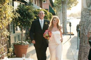 newlyweds-walk-down-charming-city-street