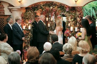 ceremony-with-twinkling-lights-and-flowers