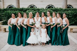 bride-with-v-neck-gown-flower-girls-stripe-skirts-bridesmaids-tassel-earrings-high-neck-white-top