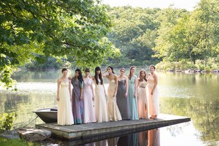 bride-in-custom-mark-ingraham-atelier-blush-wedding-gown-mismatched-bridesmaids-in-soft-colors