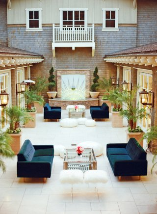 navy-blue-sofas-with-fur-stools-and-ottomans-at-wedding-reception